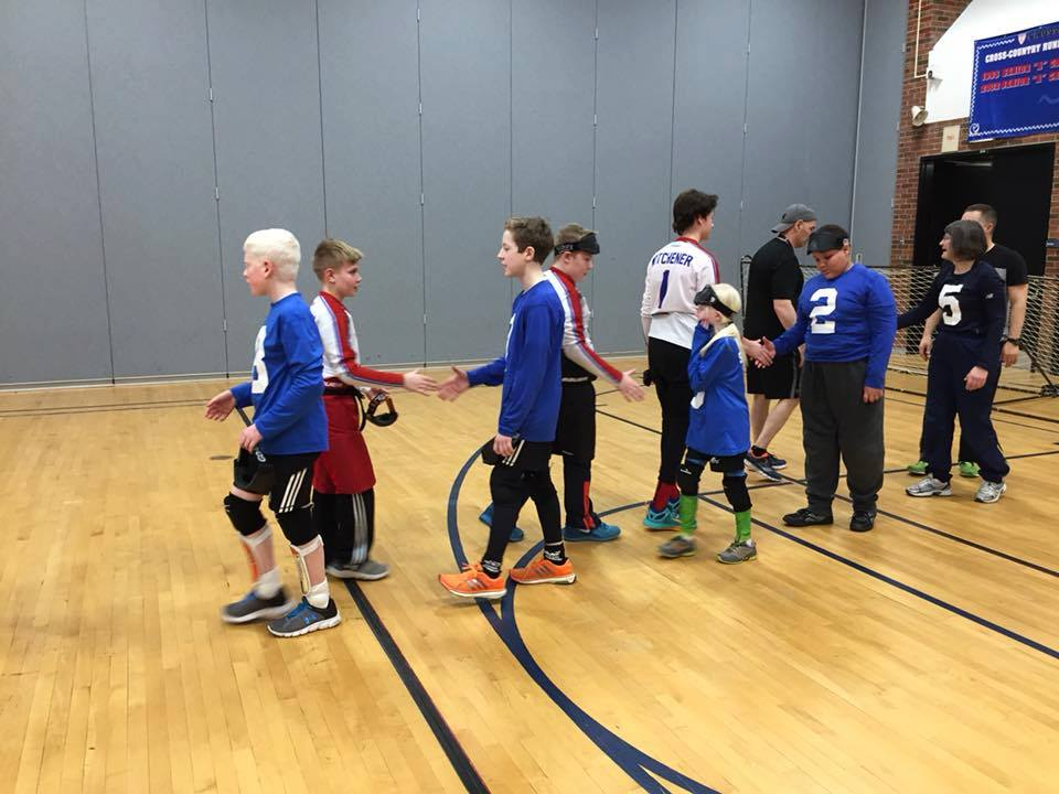 Nova Scotia youth goalball team shakes hands with an opposing team after a game.