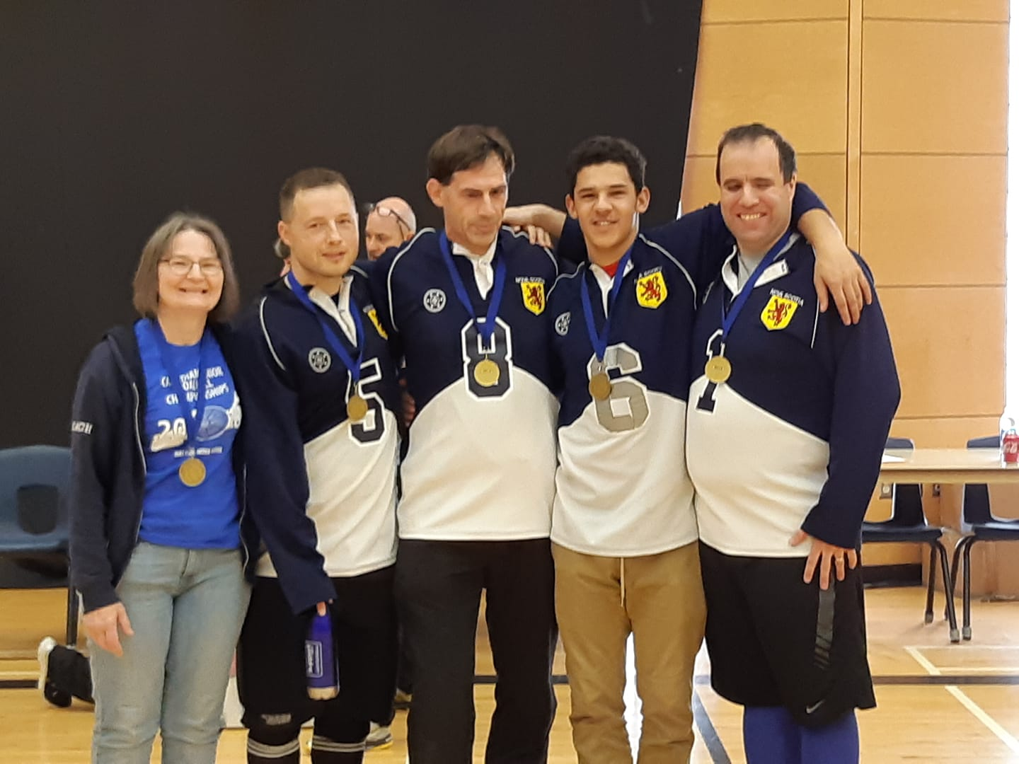 Gold Medal winning team, Nova Scotia 1 Linda MacRae Triff, Peter Parsons, Oliver Pye, Mason Smith, and John Courtney