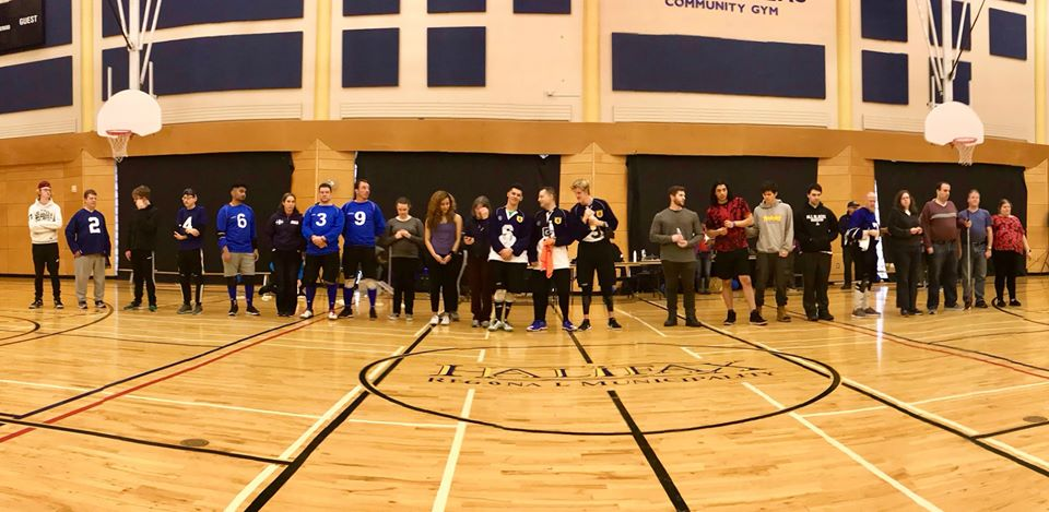 Group photo of all athletes & coaches at medals ceremony. From left to right: Bob Juniors; Quebec; NS Women; Nova Scotia; Ontario; Ship Recs