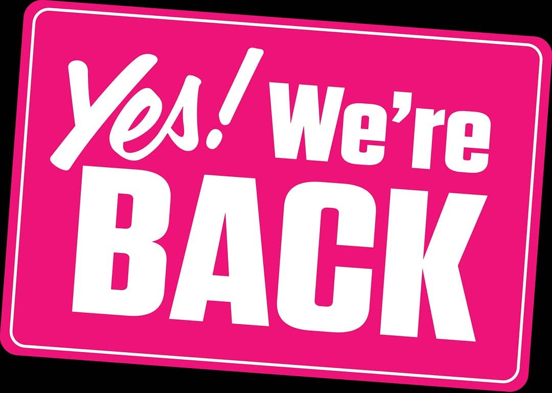 """""""Yes! We're back"""" in white text on a bright pink background"""