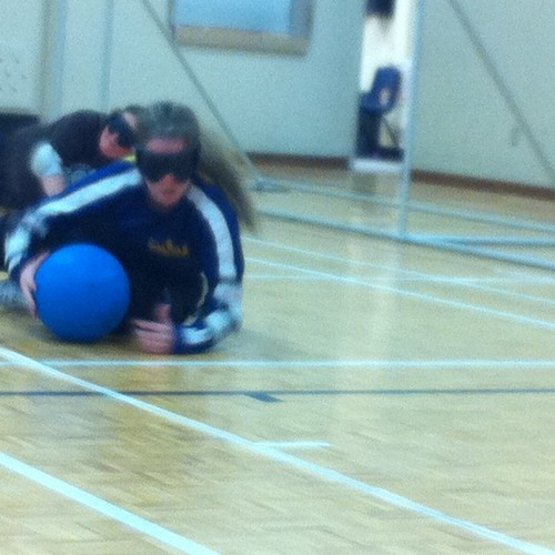 Stephanie slides to her left, blocking & grabbing the ball, while playing centre for the NS women's goalball team.